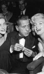 "Lauren Bacall și Humphrey Bogart alături de Marilyn Monroela premiera filmului ""How to Marry a Millionaire"" regizat de Jean Negulesco."