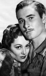 "Olivia de Havilland și Errol Flynn în ""Dodge City"" (1939)"