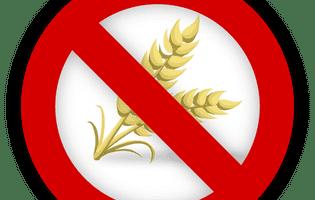 Alergiile alimentare se manifestă printr-o reacție exagerată a sistemului imunitar la consumul anumitor alimente și conduce la urticarie, eczemă, prurit. Imagine cu semn de interzis pentru grâu, un aliment potențial alergen