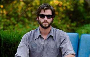 Liam Hemsworth a depus actele de divort