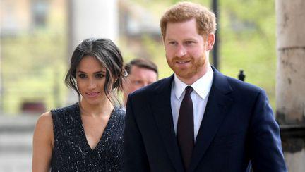 Prințul Harry și Meghan Markle zâmbind
