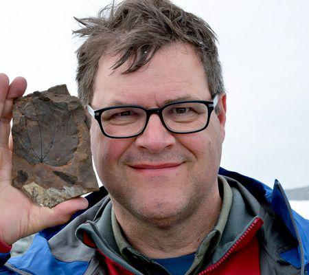 Kirk Johnson holding fossil