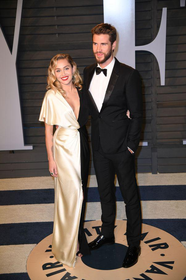 Miley Cyrus si Liam Hemsworth