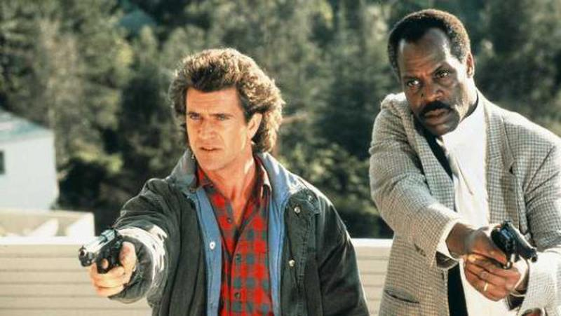 Mel Gibson și Danny Glover (Lethal Weapon, 1987)
